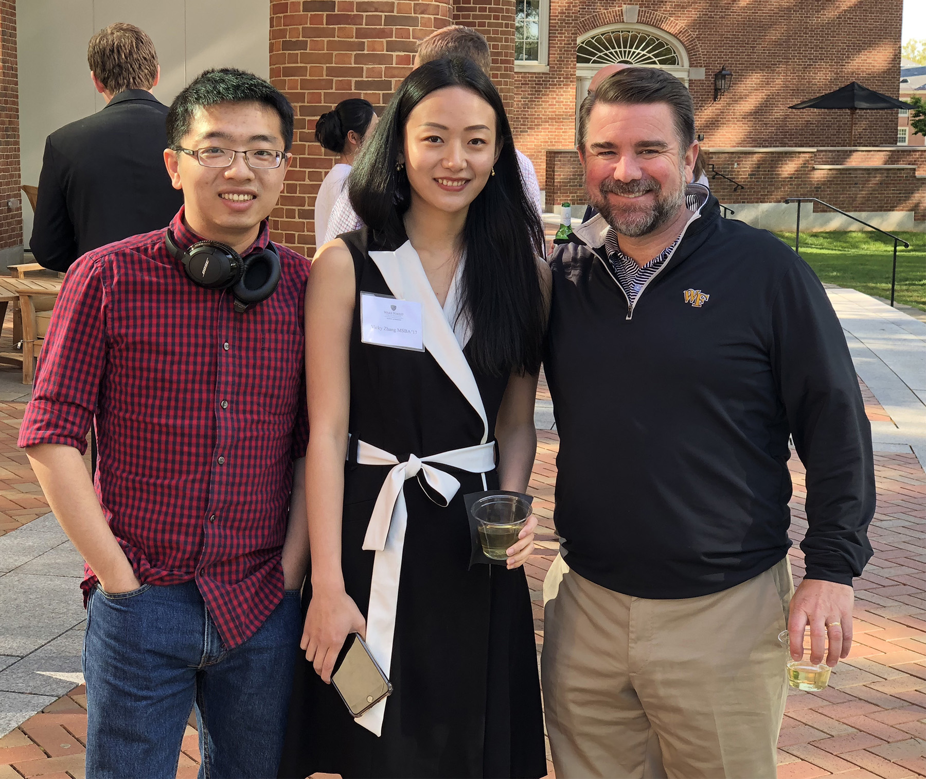 Woody Shi (MSBA '17), Vicky Zhang (MSBA '17), and John White pause their conversation for a quick photo.
